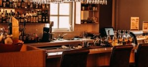 a picture of an empty restaurant bar as one of the consequences of restaurant relocation