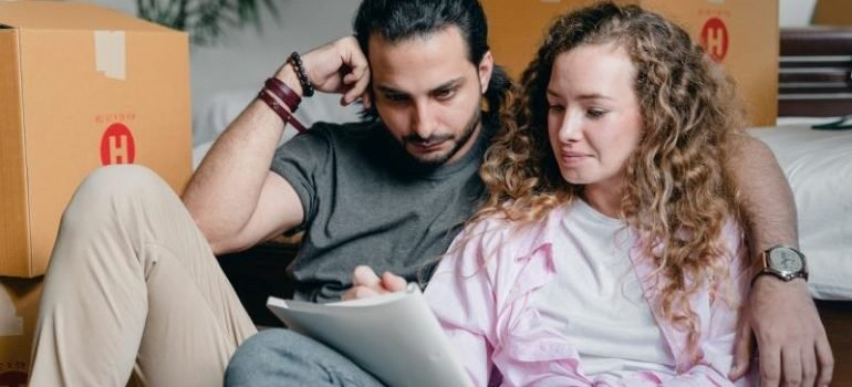 Couple making a checklist to prepare for movers