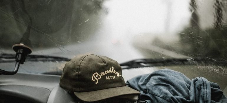 A hat in the truck that is on the road while moving a small business to Miami