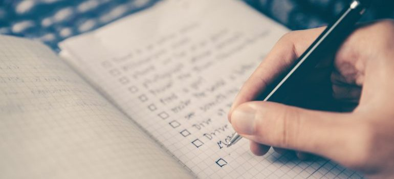 a person writing a list