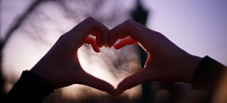 Human hands making a shape of a heart