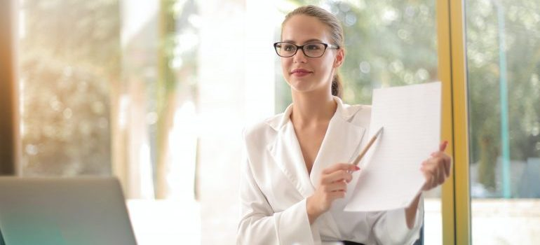 Woman holding a plan.