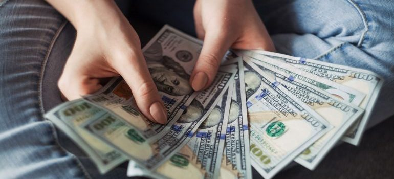 A person holding money in his hands