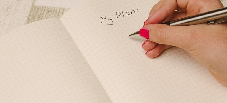 A person writing a plan on moving a 3000 sq ft house to Coral Springs