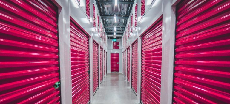 hall with storage units with pink metal doors