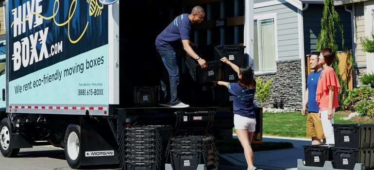 Professional movers putting items into the truck