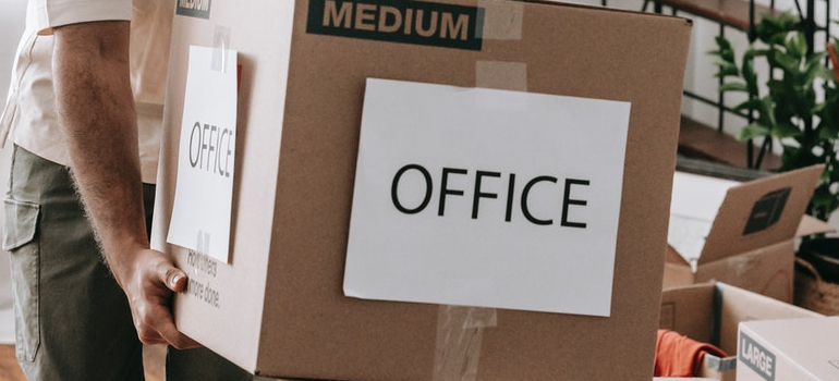 a person moving office as a part of corporate move in Miami during peak season