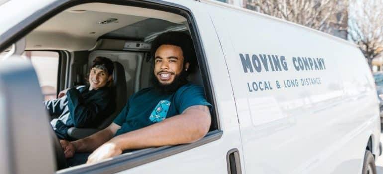 Men driving in a moving van