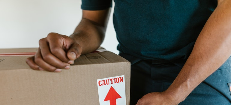 a man sealing the box