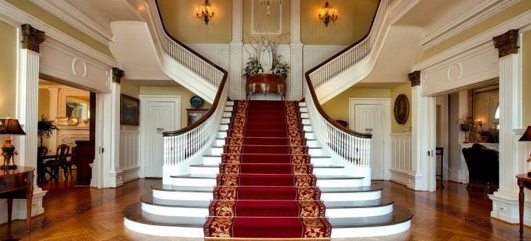 white staircase with red carpet