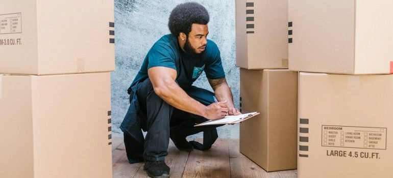 one of the white glove movers, doing inventory