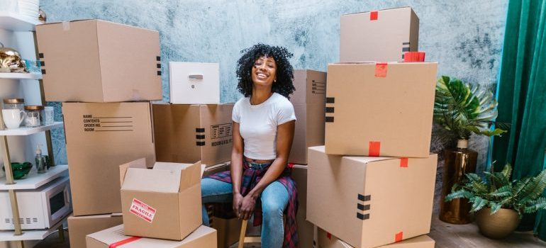 girl surrounded by cardboard boxes